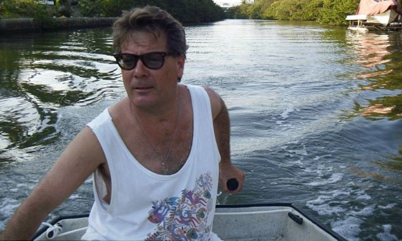 Photo of Bohdan Mazur while driving a boat.