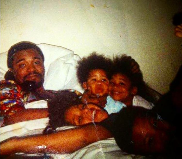 Childhood photo of Lee Daniels with his late father and siblings.
