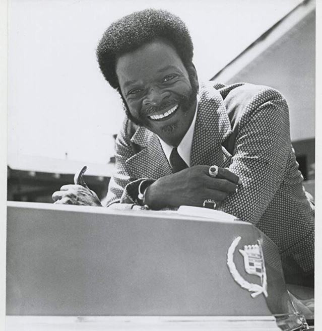 Photo of Brock Peters while smiling on the set of Black Girl in 1972.