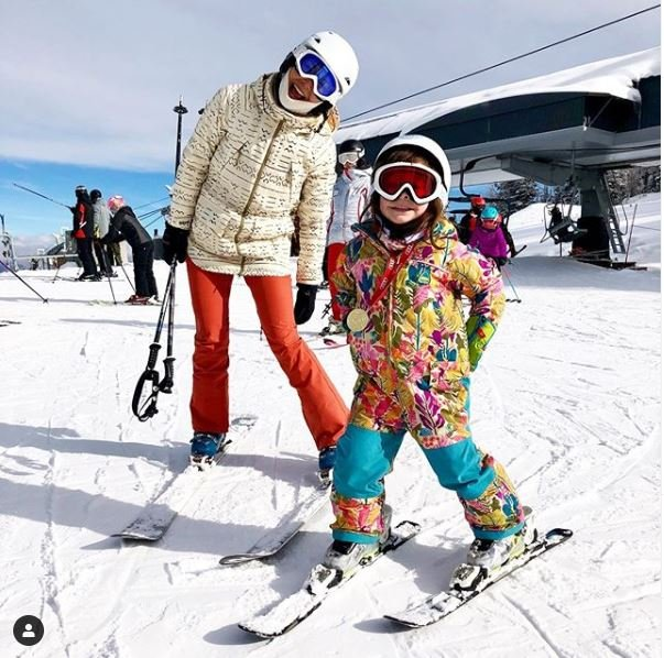 Julee Cerda skiing with her daughter in Snowmass, Colorado.