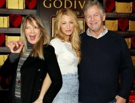 Elaine with her husband , Ernie and child, Blake