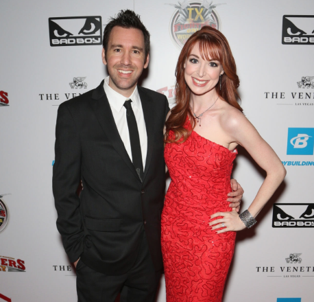 Lisa Foiles with her husband in the red carpet