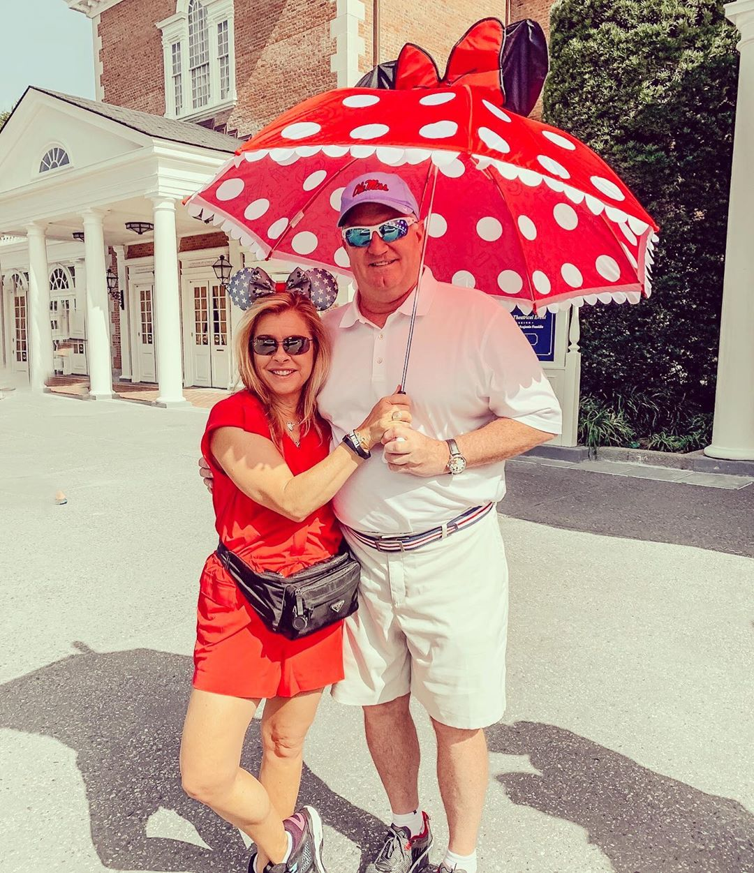 an American sports commentator look happy with his wife