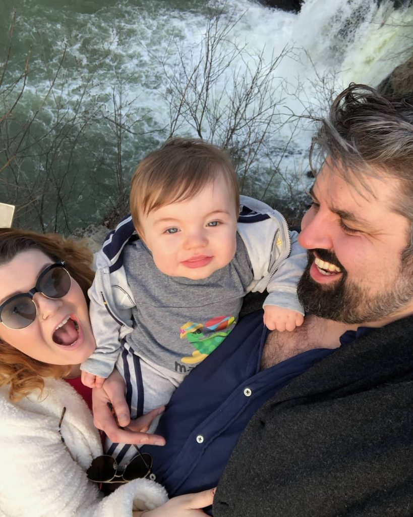 Andrew with his wife and child