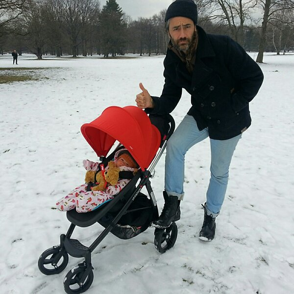 Taika with his daughter