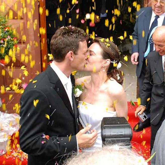 Dougray Scott and his wife Claire Antonia Forlani kissing each other at their wedding in Italy.