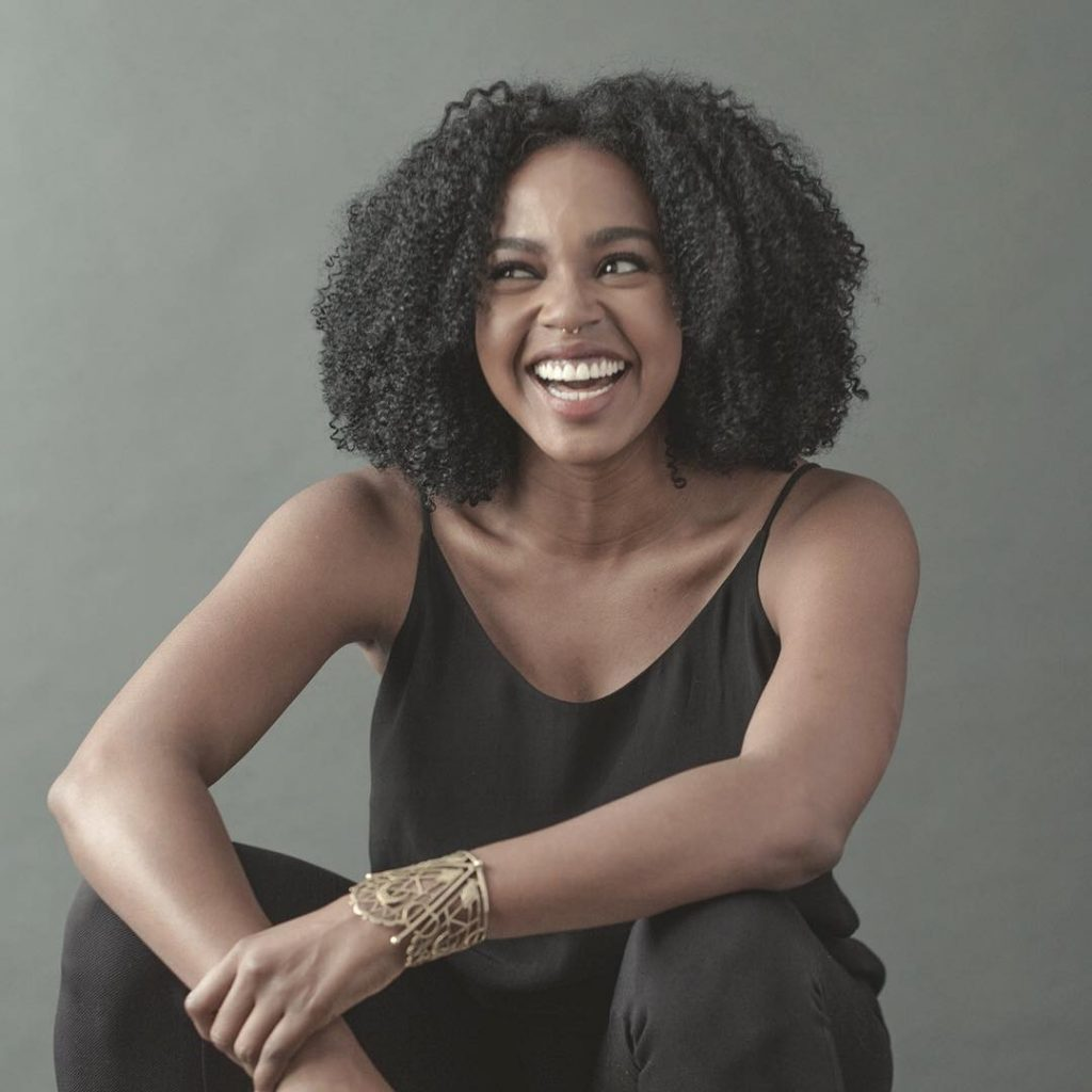 The Happy Face: Jerrika Hinton.