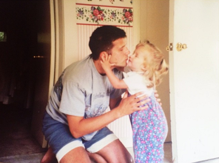 Childhood photo of Kennedy McMann with her father