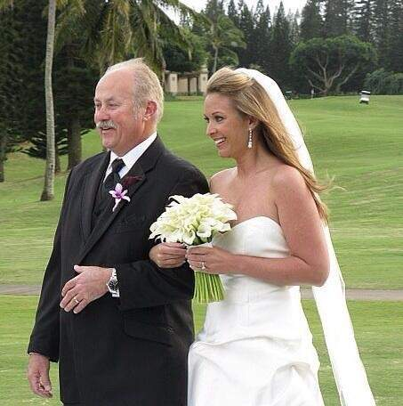Ryan Briscoe with her father on her wedding day
