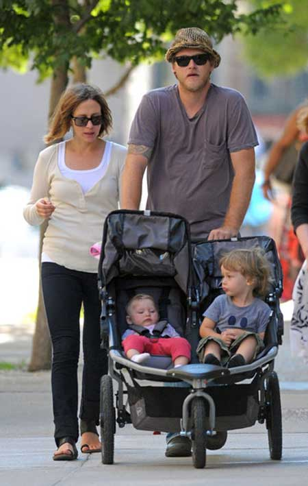 Vera Farmiga and her husband walking in the stree along with their children