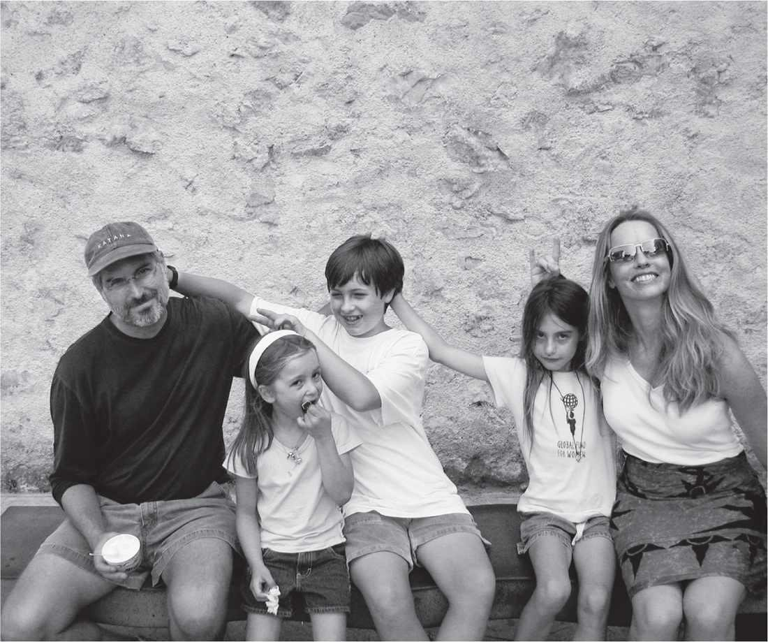Steve Jobs with his family