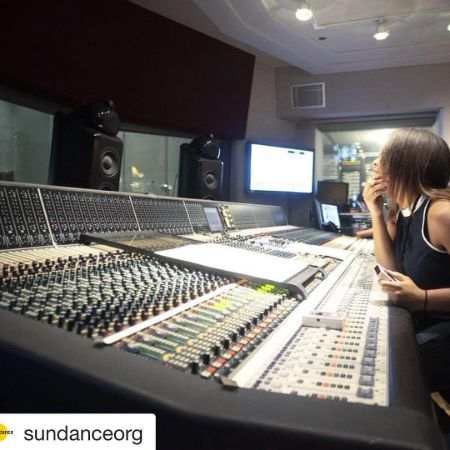 Dara concentrating on her work at a studio