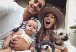 Madison Mckinley along with her husband, daughter, and two dogs