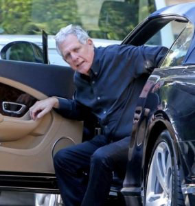 Les Moonves in his car