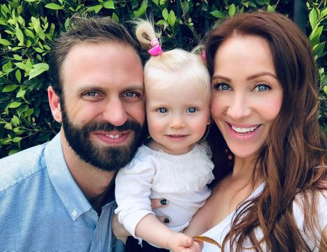 Miranda Frigon with husband Ben and daughter