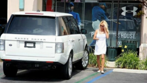 Pamela going shopping in her Range Rover.