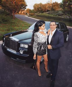 Manny with his wife in front of brand new Rolls Royce.