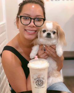 Brigette holding her dog Mimi.