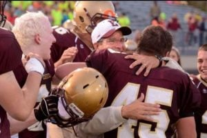 Al Minnaert hugging Eric Popovich after winning against Portage at Otto Breitenbach Stadium