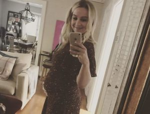 Allie Wood showing off her baby bump