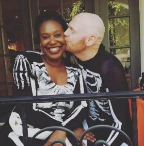 Bill Burr kissing his wife, Nia Hill