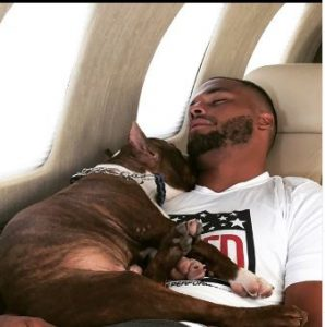 Dak Prescott traveling on the Nicholas Air with his dog