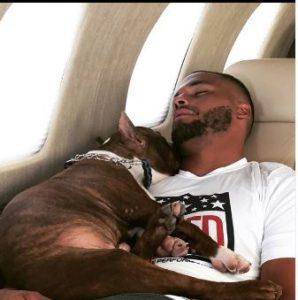 Dak Prescott traveling on the Nicholas Air with his dog