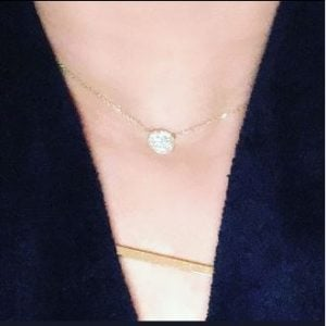 Jennifer Brennan posts about her new necklace from Golden Thread Inc.