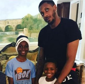 Mario Chalmers with his sons