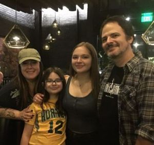 Rob Bonfiglio with her spouse and two daughters