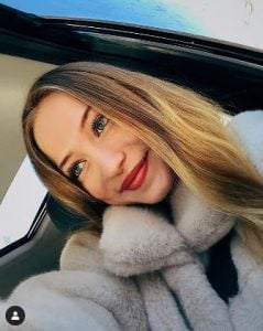 Sophia Diamond captures a picture in her car