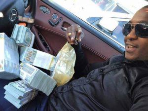 Steve posing with stash of cash.