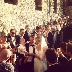 Alan walking down the aisle with wife Gabrielle and daughter.