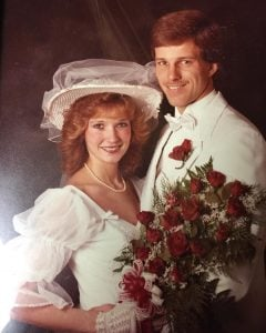 Kimberly Weems with her husband John on their marriage day.