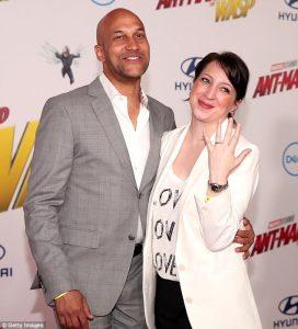 Elisa showing her wedding ring alongside her husband Keegan.