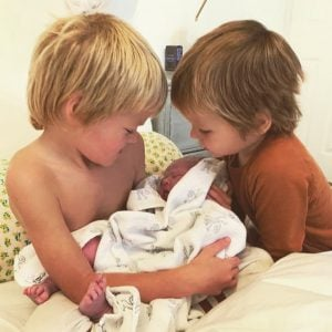 Alan Pownall children playing with his third child Skye.
