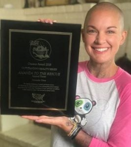 Amanda Giese flaunting her Humane Society Genesis Award for Animal Welfare