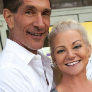 Julie Michaels with her husband Peewee Piemonte smiling at the camera