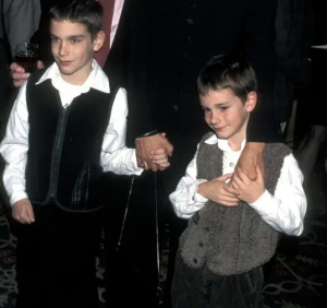 Cooper with his elder brother during an event.