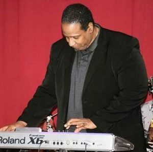 Maurice Starr while playing piano