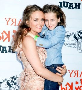 Bear blue with her mother during an event.