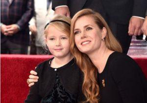 Darren Le Gallo and Amy's daughter Olivia.