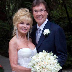 Elisa with her husband Bob flick on her wedding day.