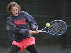 Merri Kelly Hannity of Cold Spring Harbor returns a volley during the Nassau County.