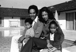 Jason Simpson with her father, mother and sister, Arnelle.