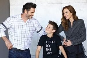 Sarah took a picture with her husband and son