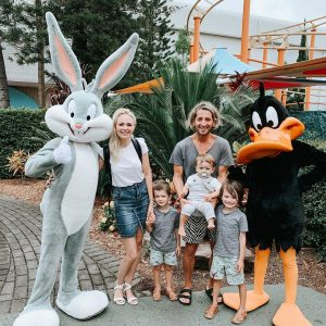 Jane and her family taking a picture in Warner Bros, Movie World