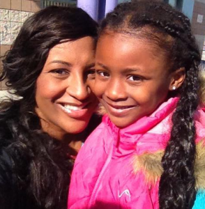 Shaya Bryant with her daughter who is wearing a pink jacket