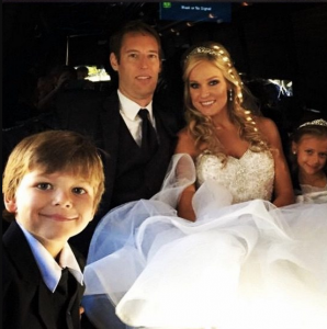 Mike Whickham is Wife Heidi Watney during their wedding.