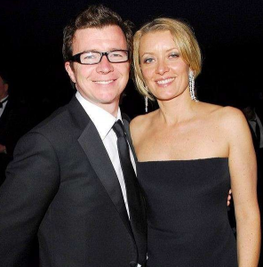Rick Astley posing for a picture with his wife Lene